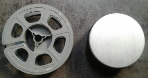 25ft film reel in silver can compared to 50ft reel